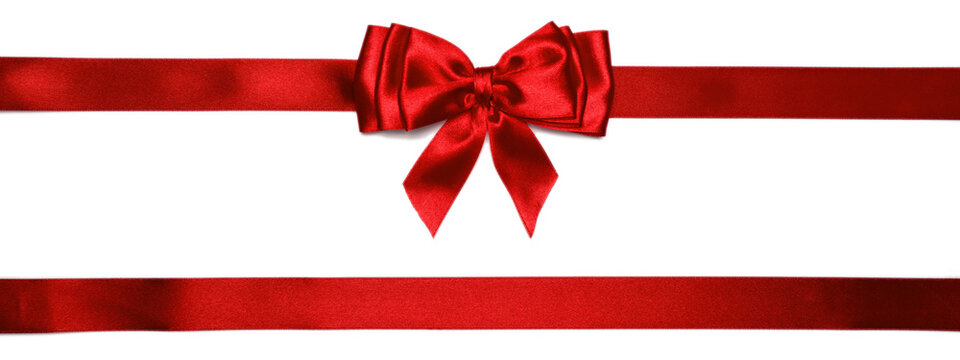 Red shiny bow with ribbons with long ribbon extending on both sides.
