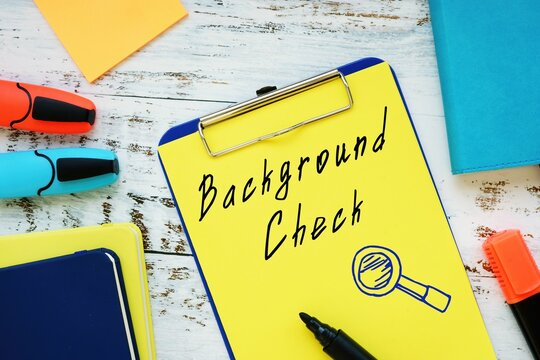 Financial concept about Background Check with sign on the page.