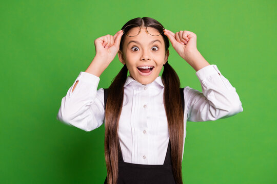 Photo of lovely pretty small lady in front of blackboard take off eyewear open mouth excited see interesting picture biology lesson wear white shirt glasses isolated green color background