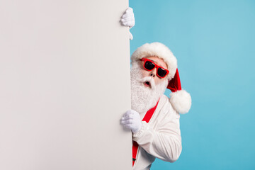 Portrait of his he nice attractive funky amazed astonished wondered white-haired Santa holding copy empty blank place space novelty isolated over bright vivid shine vibrant blue color background
