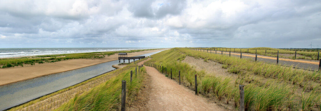 Coastal protection dike near Petten (Netherlands); it has between 2013 and 2015 been reenforced with 20 million m3 of sand, creating two additional rows of dunes and a waterbird area with lookout.