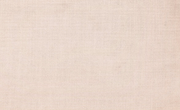 Close up beige linen fabric texture background