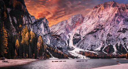 Stunning view of mountain lake Lago di Braies in autumn during sunset. Autumn landscape of alpine lake Braies, Pragser Wildsee. Iconic locations for landscape photographers. creative artistic image