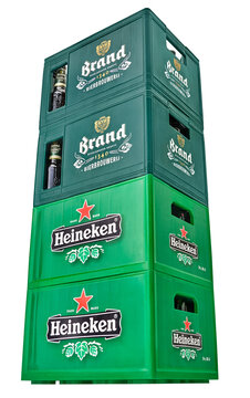 Netherlands, Haarlem - 14-01-2020: Heineken and Brand beer crates in a studio setting, isolated on white