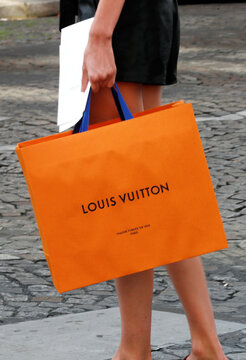Louis Vuitton-branded shopping bag