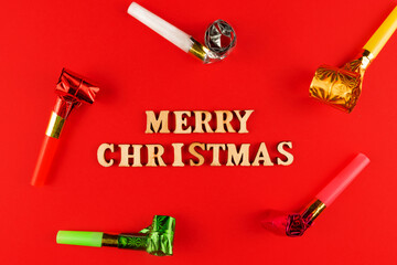 wooden letters on red background. Merry christmas lettering in red paper. Copy space