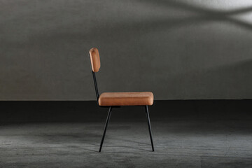 Wooden chair with metal legs in a studio