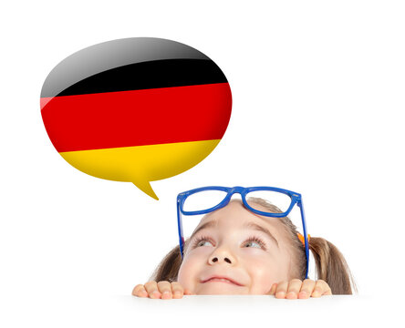 beautiful cute little girl hiding under table and curiously looking at the Germany flag speech ballon above her head