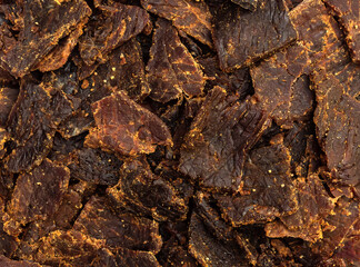 Beef jerky. Close up. Food background.