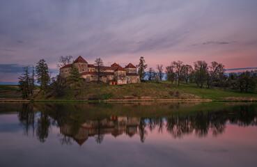 Ancient Svirzh castle at sunset in april 2020. Svirzh village, Lviv region.