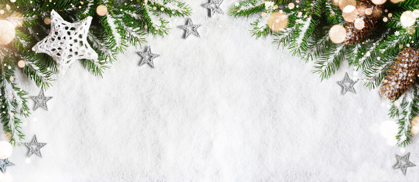 Christmas background, green pine branches, cones on snow background and light. Creative composition, top view. New Year's, holiday, christmas, decoration.