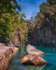 Koprulu Canyon. A view of Kopru River and Koprulu Canyon. National Park in the province of Antalya, south western Turkey. The canyon is crossed by the Roman Oluklu bridge. July 2020,long exposure shot
