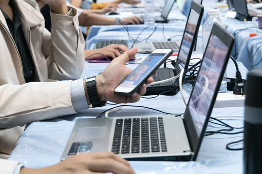 Asian Teacher groups computer training in technology or application in smartphone with laptop for Developing program to manage teaching learn in classroom at university. E-learning education online