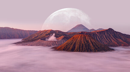 Beautiful landscape with Mount Bromo volcano viewpoint in Bromo Tengger Semeru National Park at sunrise in the background full moon