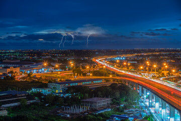 Samutprakarn cityscape. View of main highway with lightning on the sky at night at Samutprakarn in Thailand.