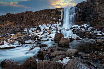 Oxararfoss waterfall in Pingvellir National Park in iceland. Edit picture for beautiful sky, clouds and sunlight.