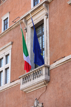 balcony of Piazza Venezia in Rome with the flag of Italy and Eur