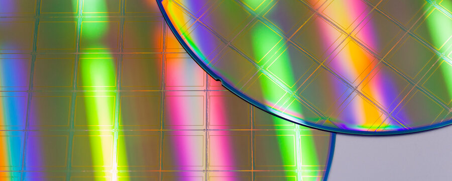Macro of blue silicon wafer with microchips. Banner format.