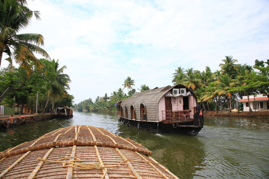 Scenic view of Houseboat sailing on Kerala backwaters in Kumarakom, Kerala, India