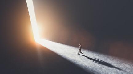 Fototapeta Businessman walking towards an open gate of light. obraz