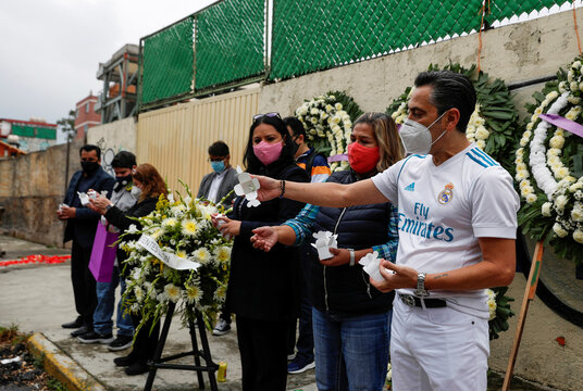 Relatives of children that died in the Enrique Rebsamen school during an earthquake in 2017 release butterflies as they pay tribute outside the school, in Mexico City