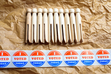 Wooden clothespins on stickers with I voted today during the American elections.