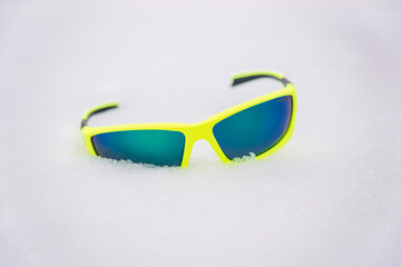 Sports sunglasses are important to protect the eyes in the snow, object on the snowy ground of the mountain.