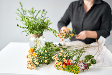 Series, step by step installation of flowers in a vase. Flowers bunch, set for home. Fresh cut flowers for decoration home. European floral shop. Delivery fresh cut flower.