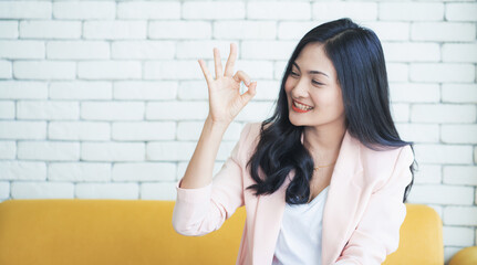 Portrait of asian woman showing ok sign