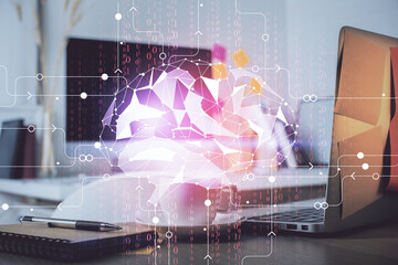 Double exposure of work space with computer and human brain drawing hologram. Brainstorm concept.