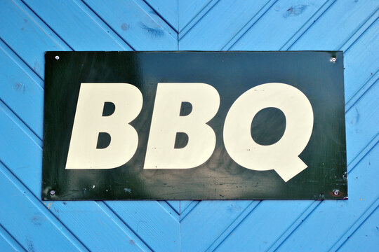 Prominent Public Metal BBQ Sign on Painted Timber Wall