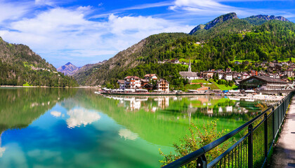 Amazing alpine scenery, Dolomites mountains. Beautiful lake and village Lago di Alleghe, northern Italy (Belluno province)