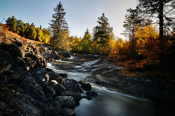 Long exposure of a river in autumn landscape. Wild nature of Norway, Hallingdal.