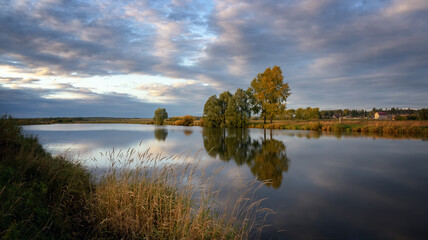 autumn landscape on the Ural lake with birch trees on the shore, Russia