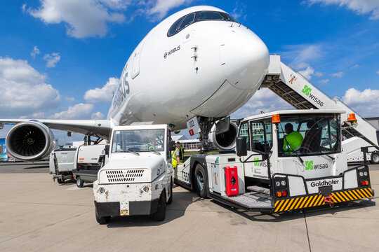 BERLIN, GERMANY - APR 27, 2018: New modern Airbus A350 XWB passenger jet plane about to be towed by an airport towing vehicle on Berlin-Schonefeld International Airport.