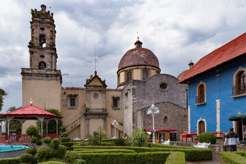 Catholic church, colonial buildings and park of a Mexican town
