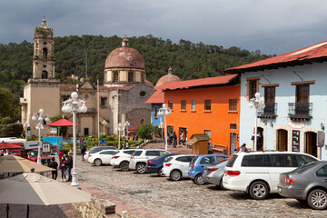 Catholic church and colonial buildings of colorful mexican town