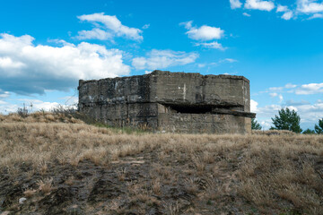 Concrete bunker at former military training area Jueterbog in late summer