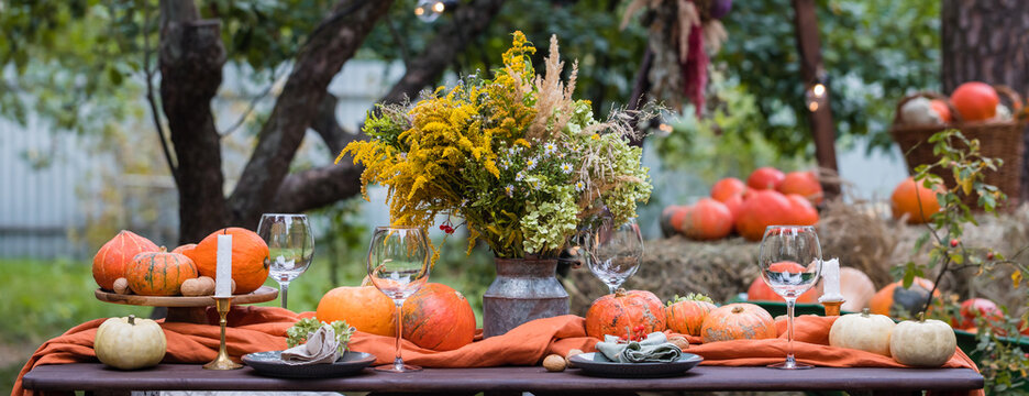 Fall themed holiday table setting arrangement for a seasonal party, banner