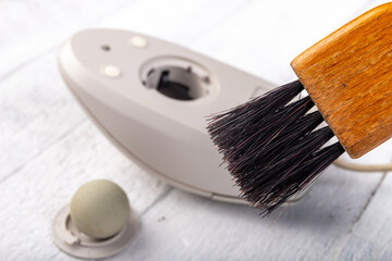 Cleaning with a brush of an old mouse. Office accessories for work.