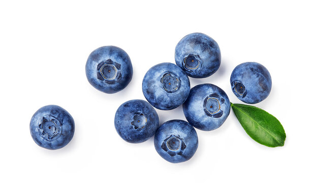 Fresh blueberries with bluberry leaves isolated on white background. Top vew of berries.