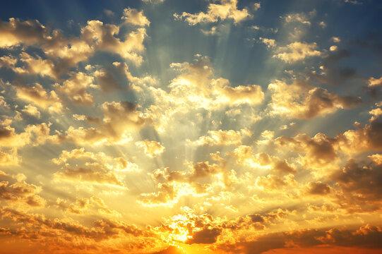 sunrise sky, sunlight shining through clouds in morning