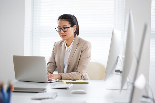 Portrait of asian business woman at workplace in office
