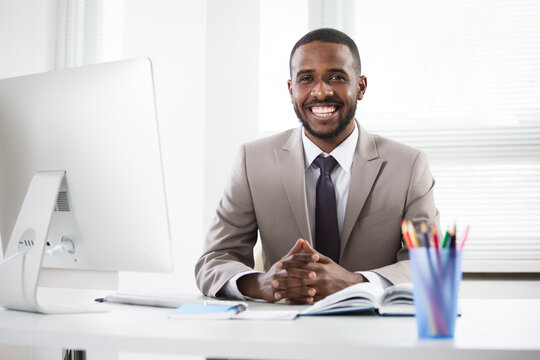 Young african american businessman working alone in the office