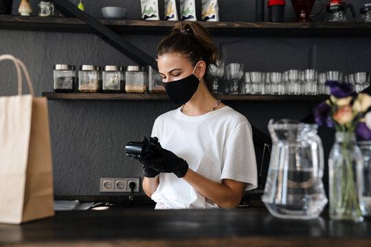 Woman bartender wearing medical mask