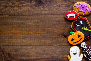 Halloween holiday background with cookies, top view