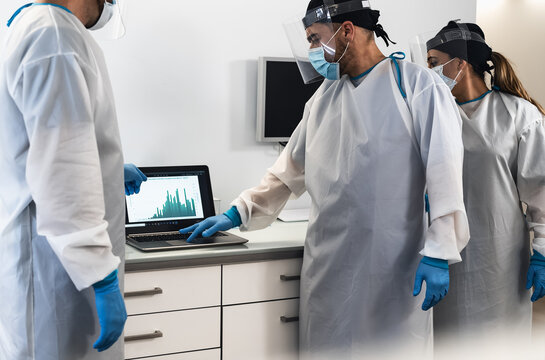 Specialist doctors fighting against corona virus outbreak - Science and medical teamwork examining pandemic cases graphic - Healthcare and covid-19 emergency concept