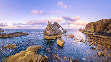 Bow Fiddle Rock during sunset - A natural sea arch near Portknockie on the north-eastern coast of Scotland