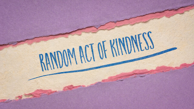 random act of kindness inspirational note - handwriting on a handmade paper, social concept