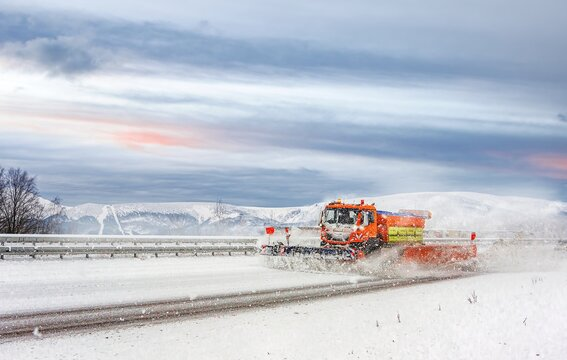 a truck on the winter road, Winter service